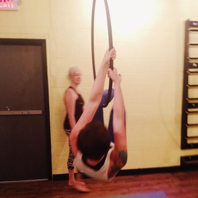 side climbing an aerial hoop